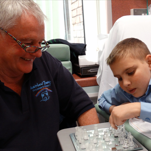 Family Support Worker Steve plays chess with Michael in hospital