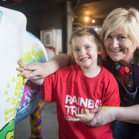 Children paint Rainbow Trust Children's Charity's cow for CowParade Surrey