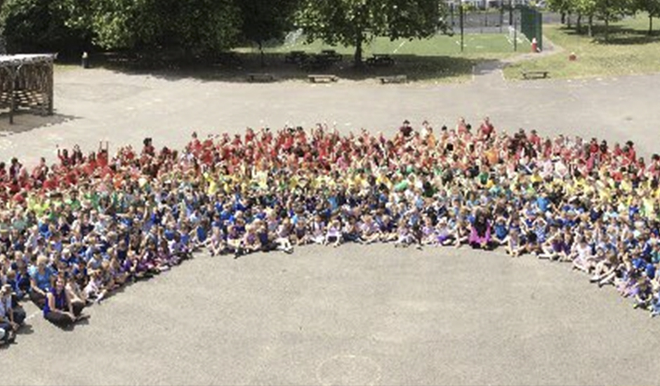 Danetree School's human rainbow in aid of seriously ill children